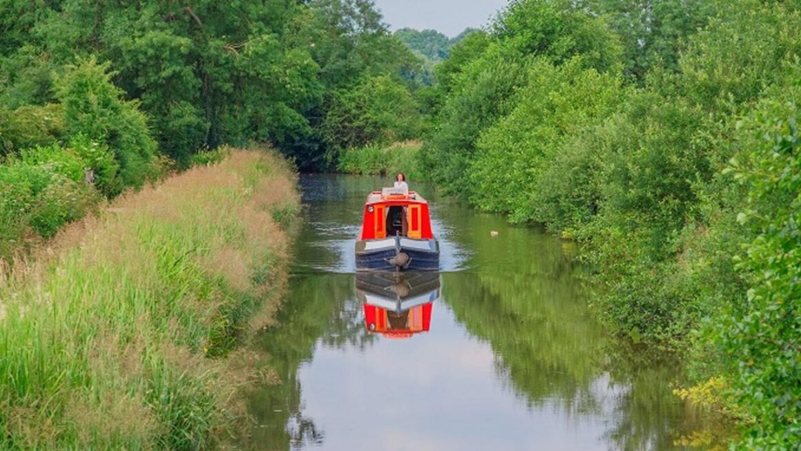 how to live on a canal boat - boat cruising down the canal