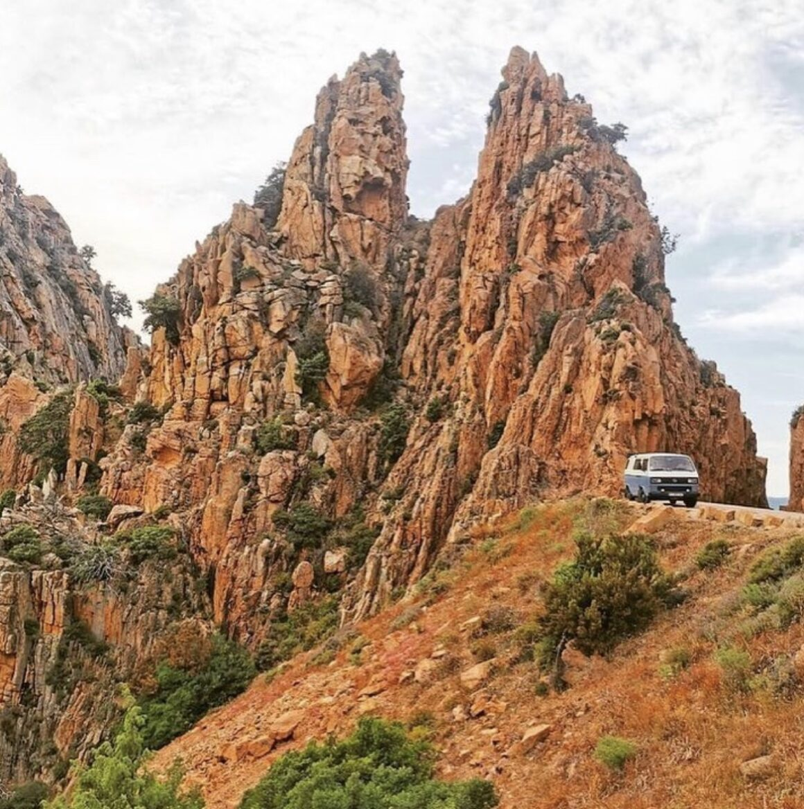 van life parking tips - camper parked by large rock structure